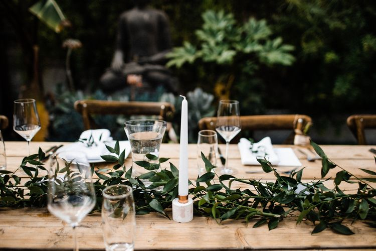 Table Decor with Foliage Runner and Taper Candle
