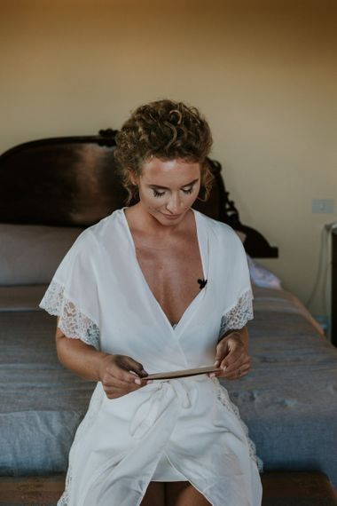 Bride on Wedding Morning Reading Card From Her Husband-To-Be