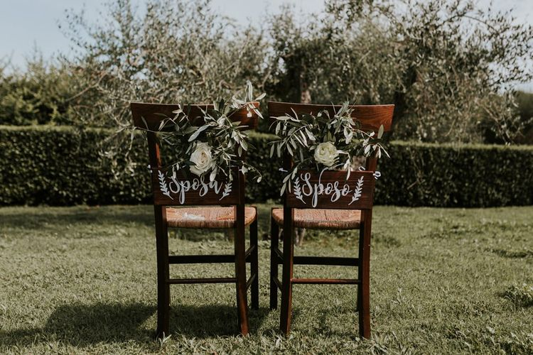 Chair Back Wedding Flowers and Wooden Signs