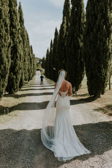 Bride in Sottero & Midgley Wedding Dress Walking Towards Groom During First Look Moment