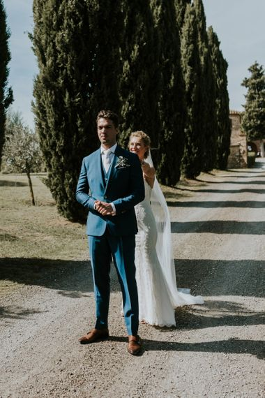 First Look Moment with Bride in Sottero & Midgley Wedding Dress  and Groom in Three-piece Navy Wedding Suit
