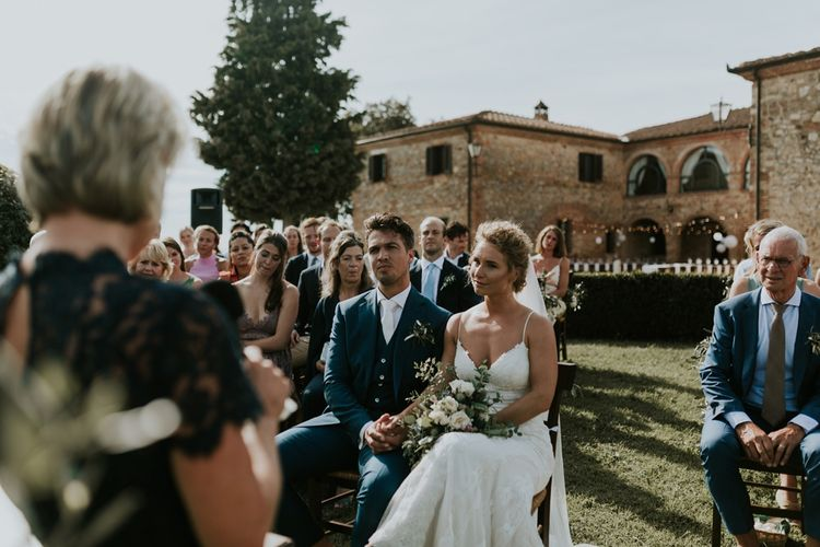 Outdoor Tuscan Wedding Ceremony with Bride in Sottero & Midgley Wedding Dress and Groom in Navy Suit