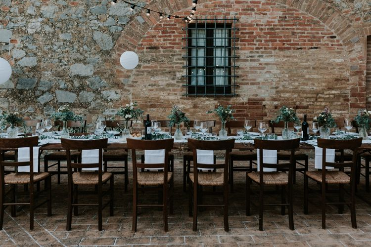 Outdoor Tuscan Wedding Reception Decor with Festoon Lights and White Lanterns