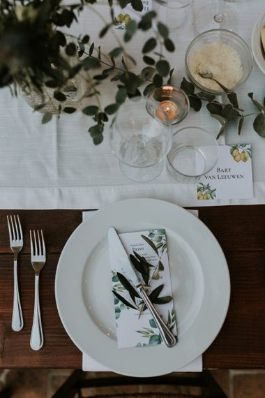 Place Setting with Green and White Wedding Flowers and Stationery