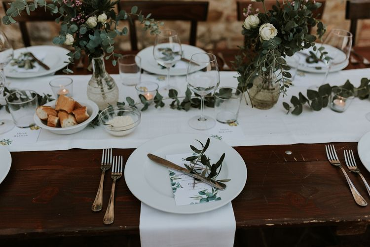 Elegant Place Settings with Eucalyptus Greenery Decor and White Flowers