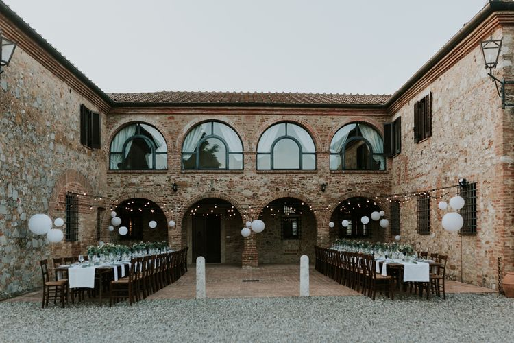 Outdoor Wedding Reception at Villa Boscarello in Tuscany with Festoon Lights, Greenery and Paper Lanterns