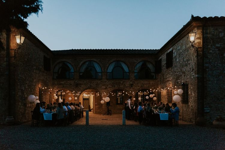 Outdoor Wedding Reception at Villa Boscarello in Tuscany with Festoon Lights