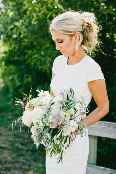 Bride in Fitted Bride in Noel and Jean Bridal Separates Holding Romantic Wedding Bouquet