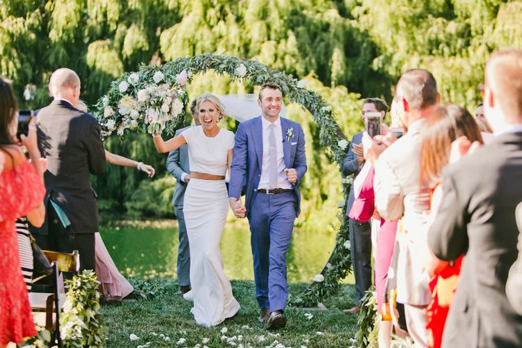 Bride in Fitted Noel and Jean Bridal Separates and Groom in Blue Suit Supply Just Married