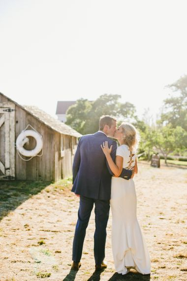 Golden Hour with Bride in Fitted Noel and Jean Bridal Separates with Lace up Back Detail and Groom in Blue Suit Supply Suit