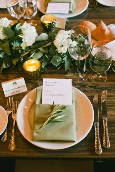 Place Setting with Menu Card Tucked into Green Napkin