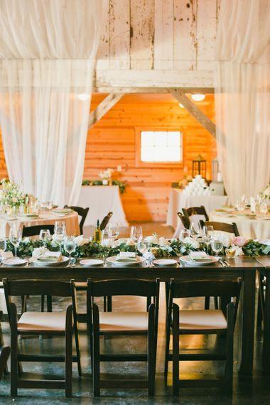 Ranch Wedding Reception Decor including  Drapes and Foliage Flower Arrangements
