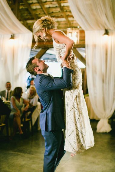 Bride in Lace Rue De Seine Wedding Dress and Groom in Blue Suit Dancing