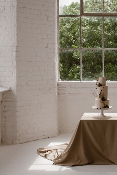 Three Tier Wedding Cake With White Icing And Foliage Decoration // Minimalist Bridal Inspiration Styled By One Stylish Day With Foliage & Dried Flowers // Bridal Wear By Halfpenny London // Images By Agnes Black