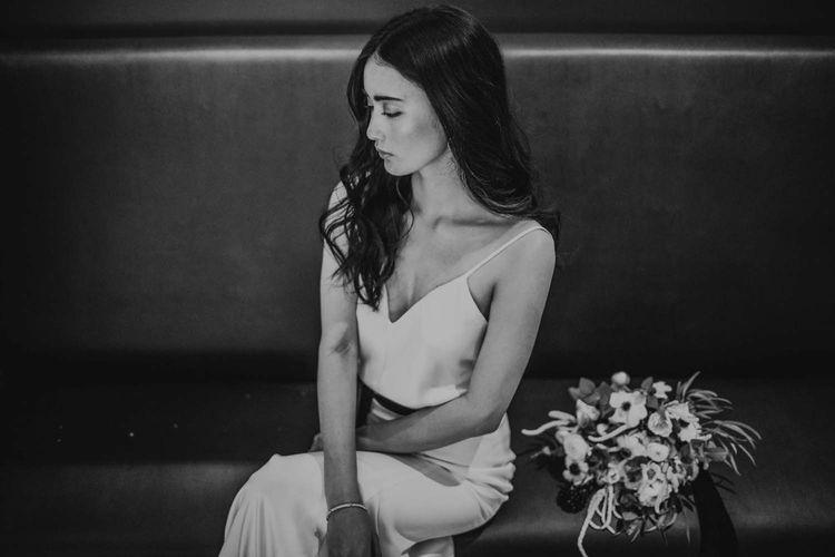 Bride in Slinky Marquis Bridal Gown | Minimalist Monochrome Inspiration with Anemone's & White Genista Flowers styled by The Bijou Bride | Igor Demba Photography | Gione da Silva  Film