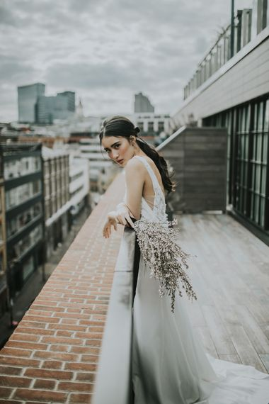 Bride in Fitted Marquis Bridal Gown with White Genista Bouquet | Minimalist Monochrome Inspiration with Anemone's & White Genista Flowers styled by The Bijou Bride | Igor Demba Photography | Gione da Silva  Film