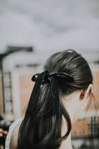 Bridal Ponytail with Black Velvet Ribbon | Minimalist Monochrome Inspiration with Anemone's & White Genista Flowers styled by The Bijou Bride | Igor Demba Photography | Gione da Silva  Film