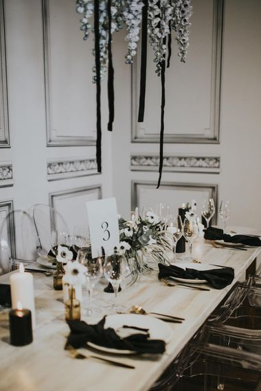 Elegant Tablescape with Ghost Chairs & Hanging Anemone Floral Arrangement | Minimalist Monochrome Inspiration with Anemone's & White Genista Flowers styled by The Bijou Bride | Igor Demba Photography | Gione da Silva  Film