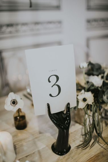 Nat's Paper Studio Table Number Stationery | Elegant Tablescape with Ghost Chairs & Hanging Anemone Floral Arrangement | Minimalist Monochrome Inspiration with Anemone's & White Genista Flowers styled by The Bijou Bride | Igor Demba Photography | Gione da Silva  Film