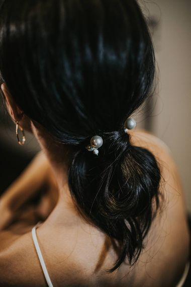 Bridal Ponytail with Pearl Hair Bobble | Minimalist Monochrome Inspiration with Anemone's & White Genista Flowers styled by The Bijou Bride | Igor Demba Photography | Gione da Silva  Film