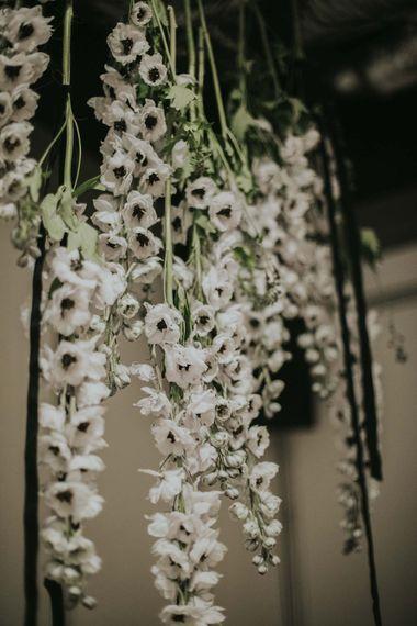 Hanging Anemone Stems Floral Installation | Minimalist Monochrome Inspiration with Anemone's & White Genista Flowers styled by The Bijou Bride | Igor Demba Photography | Gione da Silva  Film