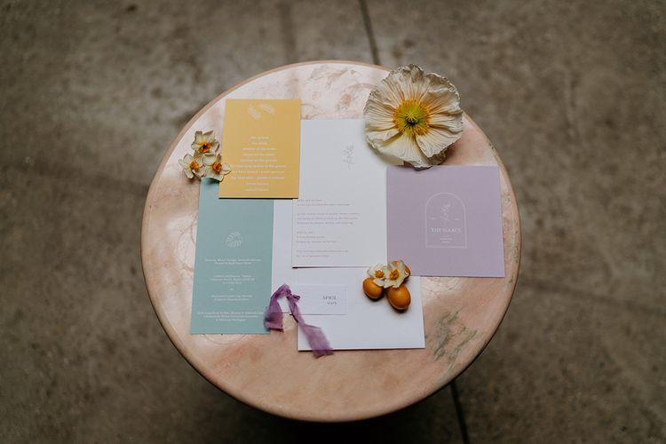 Flat lay of wedding stationery
