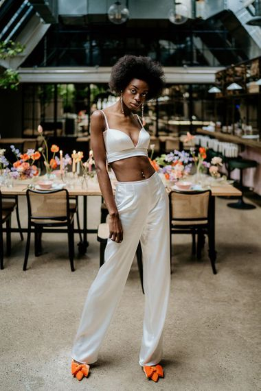 Black bride in wedding trousers outfit and bridal crop top
