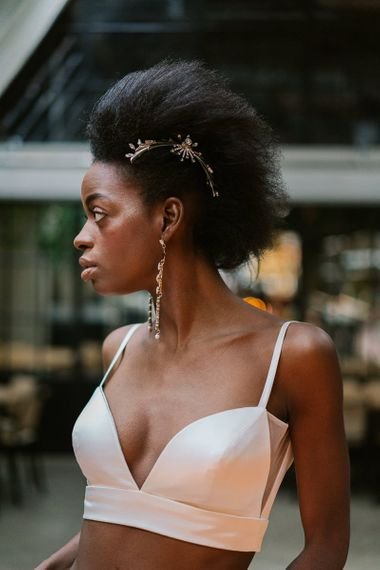 Black bride with chandelier earring and wedding hair accessory