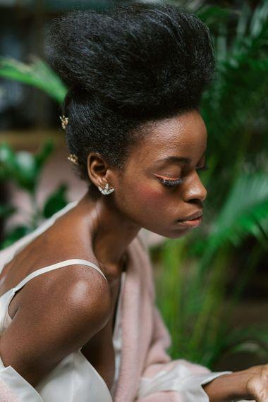 Orange winged eyeliner for black bridal makeup