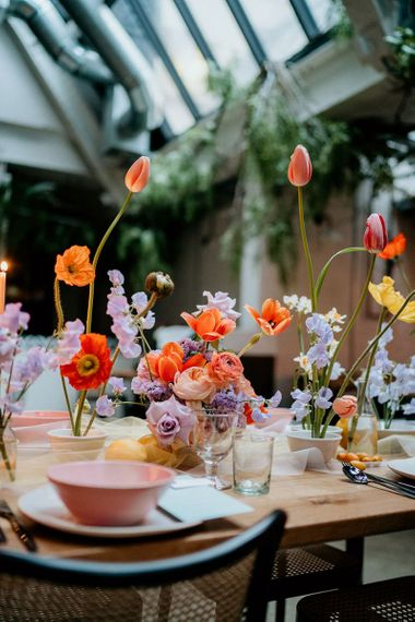 Coral and lilac spring flower centrepiece decor