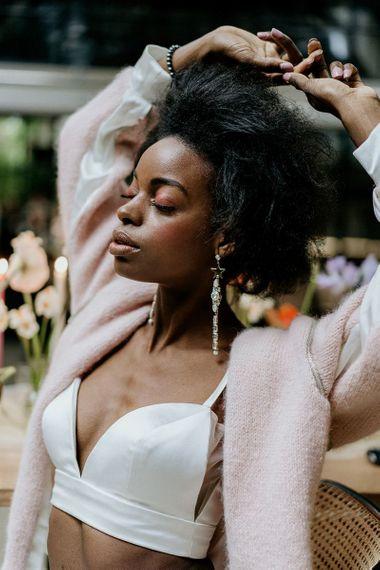 Black bride in crop top and woollen cover up