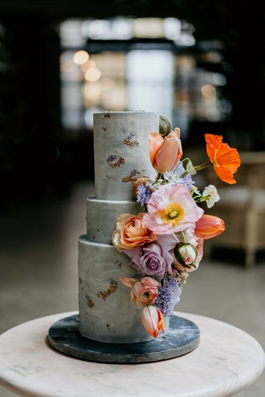 Colourful spring flowers for wedding cake decor