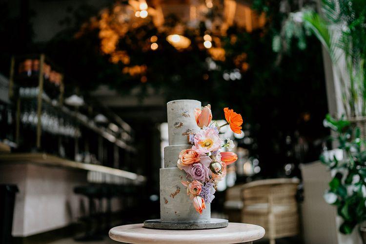 Concrete wedding cake with flower decor