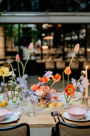 Colourful flower centrepiece with tulips and  roses