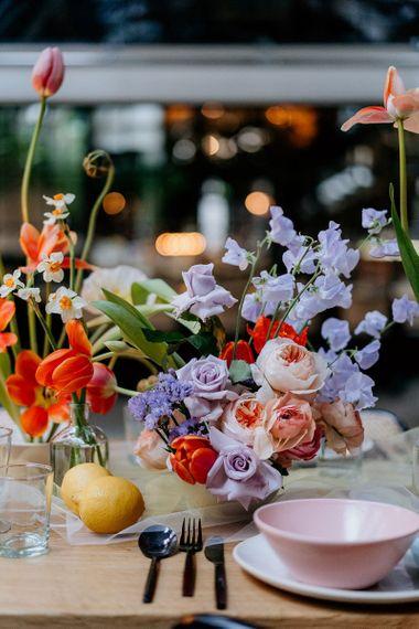 Lilac, lemon and pink spring wedding flower centrepiece