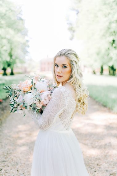 Bride in Lace Wedding Dress Holding White Peony and Peach David Austin Rose Wedding Bouquet