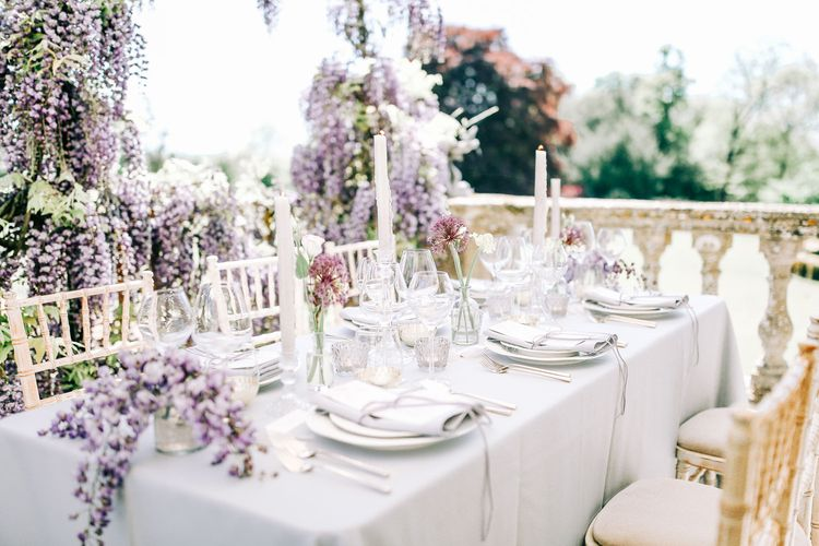 Elegant Table Scape with Taper Candles and Cut Glass