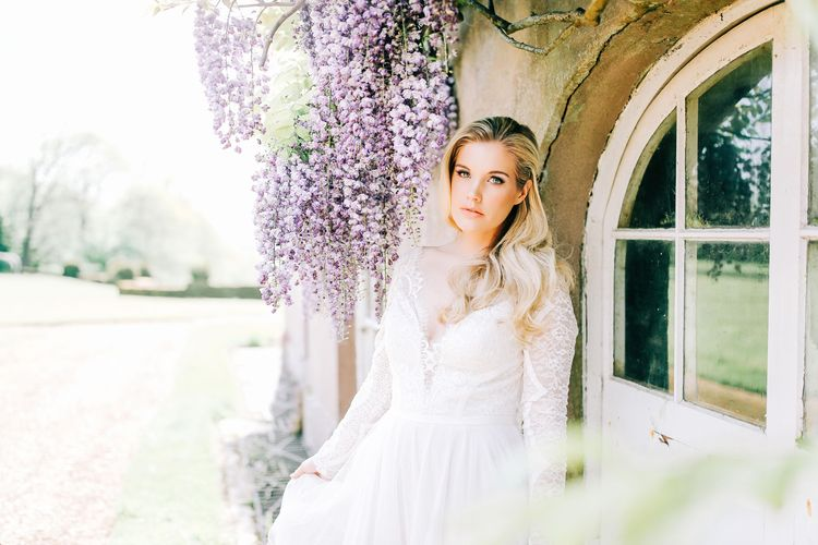 Bride in Lace Long Sleeve Wedding Dress with Half Up Half Down Hairstyle