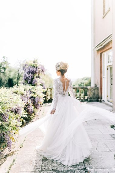 Bride in Lace Back and Tulle Skirt Wedding Dress with Pinned Bridal Bun Up do