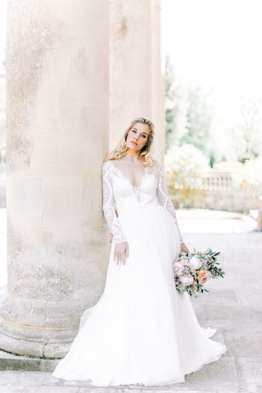Bride in Romantic Lace Long Sleeve Wedding Dress Holding Peach & White Wedding Bouquet
