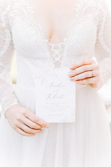Bride Holding Elegant Wedding Invitation