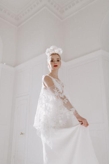 bride in minimalist wedding dress with lace bridal cape