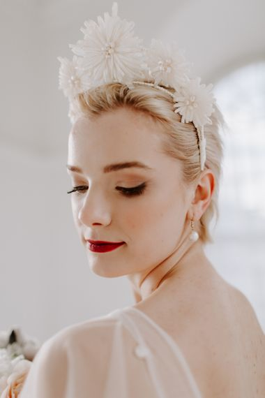 Bridal makeup up with smokey eyes and red lipstick