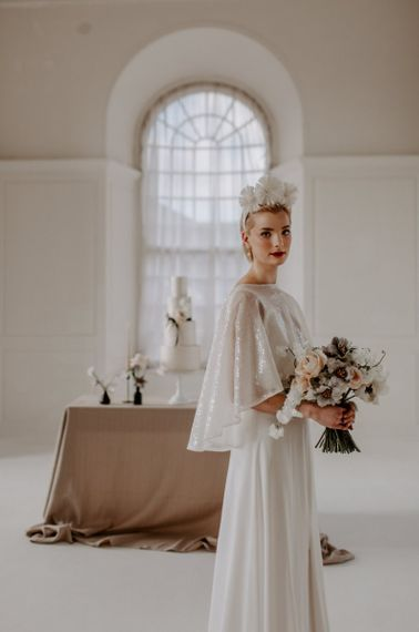 modern wedding ideas with bridal in crown and sparkly cape