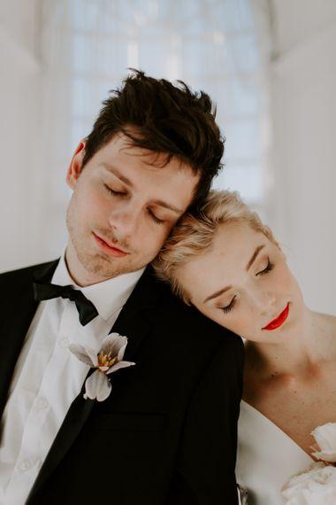 Intimate wedding portrait with bride wearing red lipstick