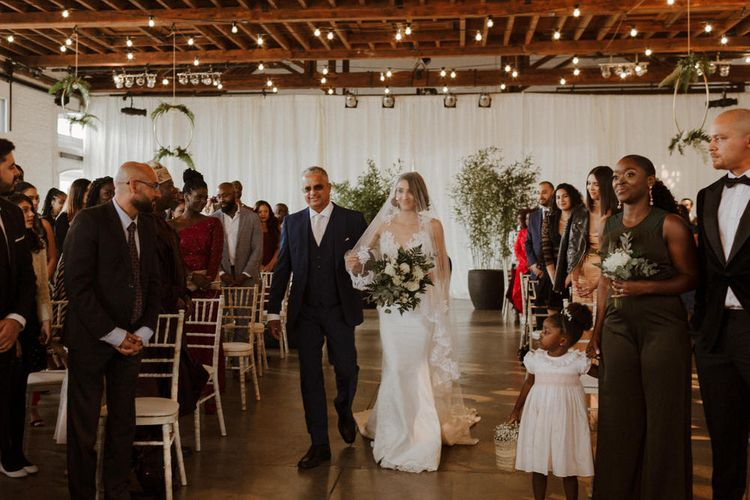 The Ceremony. Bride wears dress by Pronovias. Groom wears green velvet blazer from Gieves & Hawkes in this Green And White Luxe, City Wedding. Photography by The Curries.