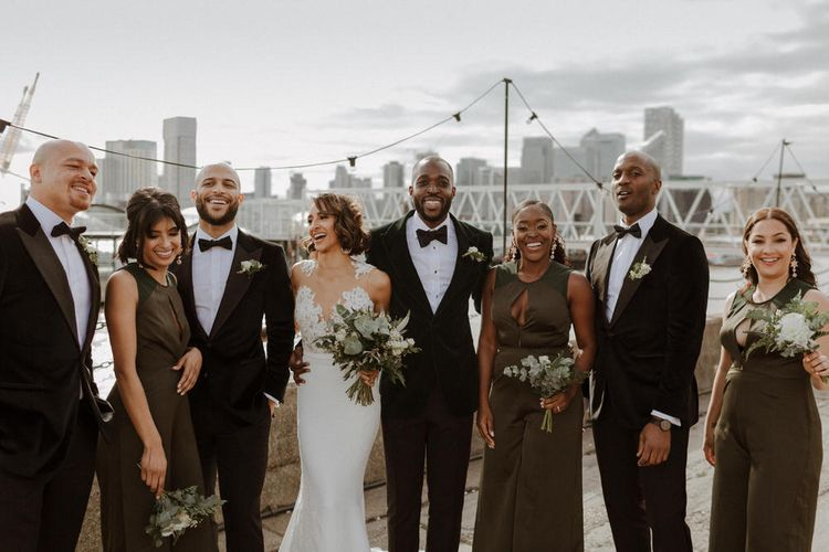 Bridal Party. Bride wears dress by Pronovias. Groom wears green velvet blazer from Gieves & Hawkes in this Green And White Luxe, City Wedding. Photography by The Curries.