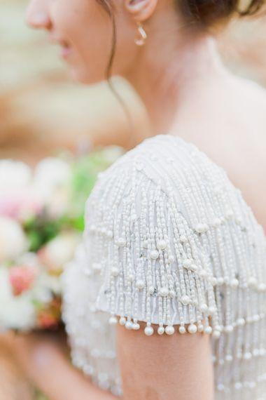 Monsoon short sleeve wedding dress with pearl beaded embellishment