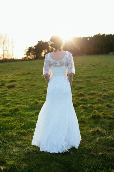 Monsoon wedding dress with laced sleeves and scoop back