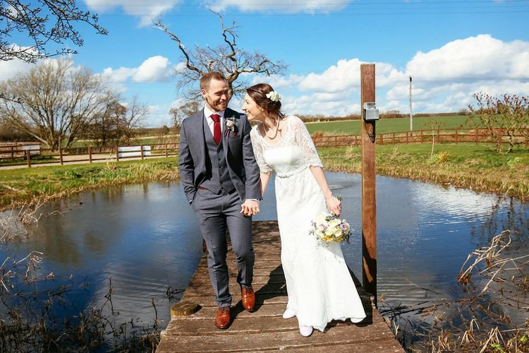 Laced Monsoon wedding dress with three quarter sleeves